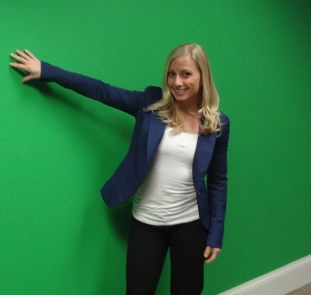 Kristin Walls is at home in front of a green screen